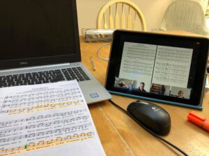 Zoom rehearsal, music, PC and tablet. Credit Clare Long